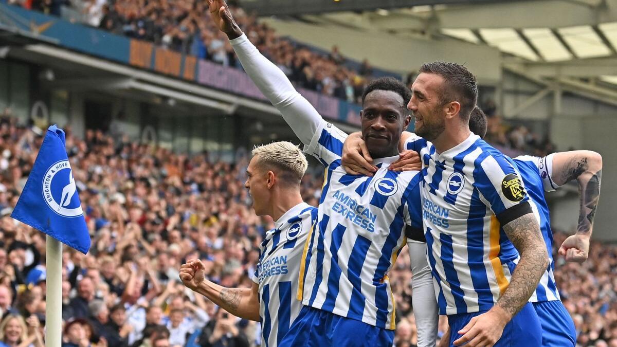 Brighton's English striker Danny Welbeck celebrates his goal with teammates. — AFP