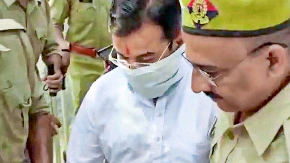 Ashish Mishra arrives at the Crime Branch office in Lakhimpur Kheri. — PTI