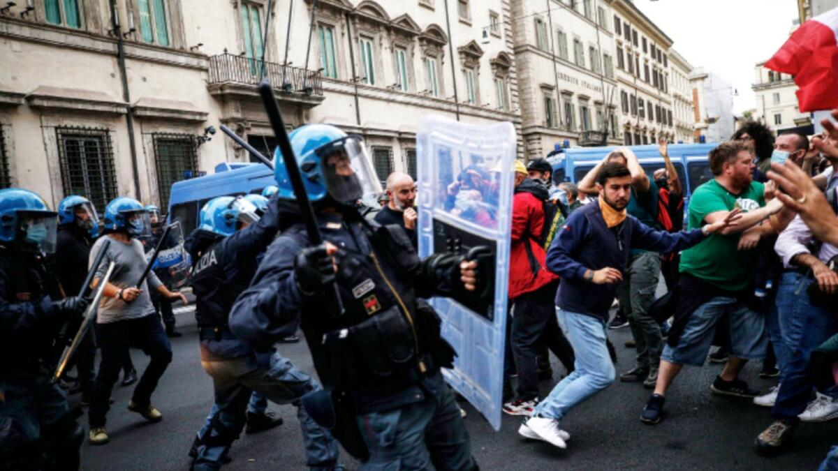 Police clashes with demonstrators during a protest against Covid-19 health pass in Rome. — AP