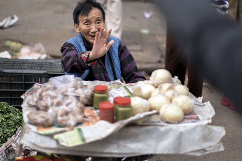 A Chinese Indian seller of sauce and steamed bread at Tiretta Bazaar