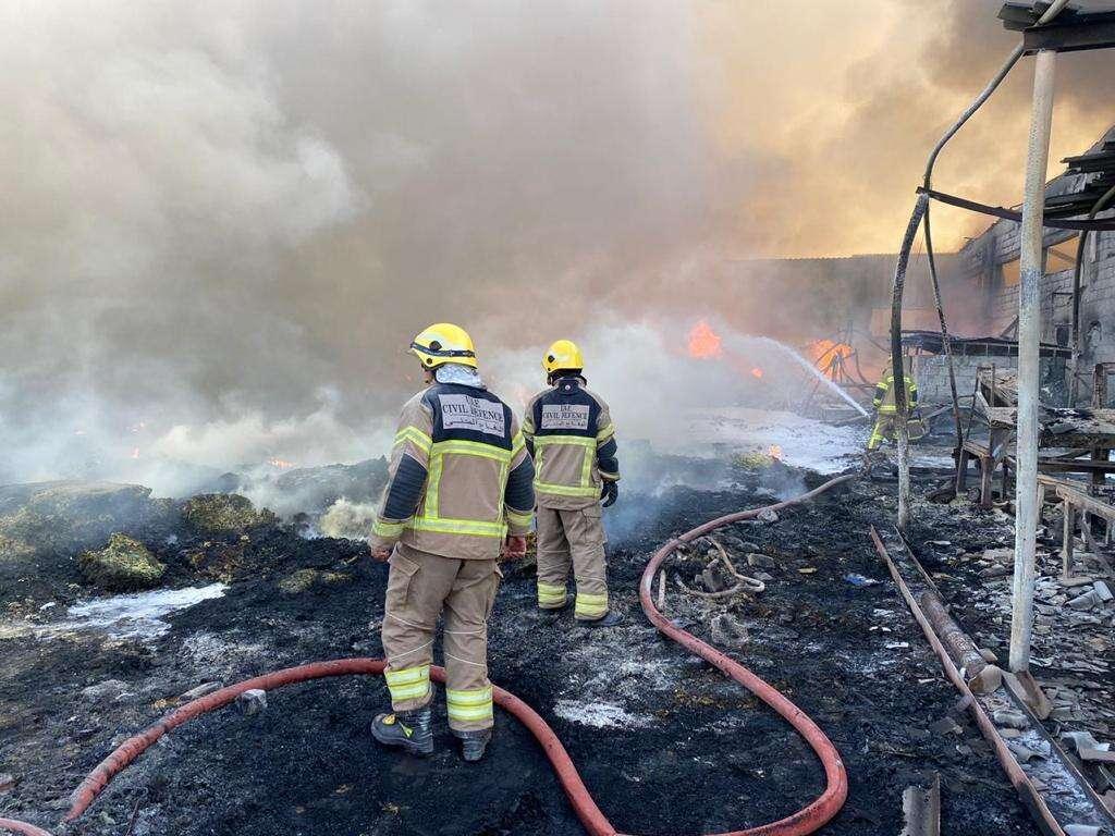 Photos, Fire, destroys, four, warehouses, Ajman