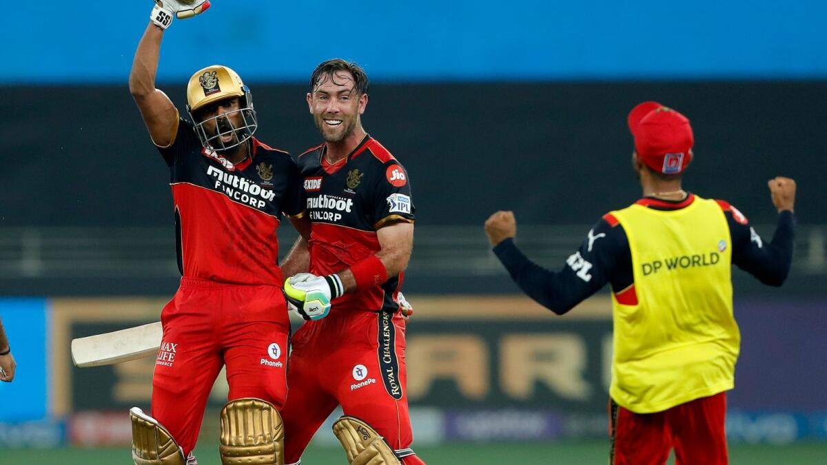 Royal Challengers Bangalore's Srikar Bharat (left) and Glenn Maxwell celebrate after defeating Delhi Capitals in Dubai on Friday. — BCCI