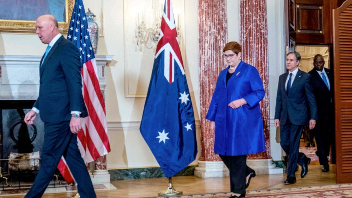 Australian Defence Minister Peter Dutton, Foreign Minister Marise Payne, US Secretary of State Antony Blinken and Defence Secretary Lloyd Austin arrive for a group photo after signing a submarine deal. — AFP