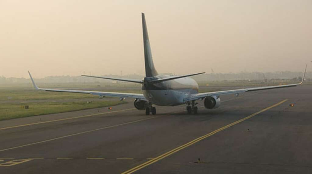 Indian airline cancels flight, passengers protest at runway