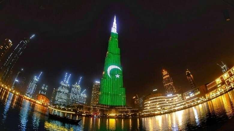 upside down flag, pakistan, flag orientation, burj khalifa, dubai, independence day, light show, pakistanis, expats