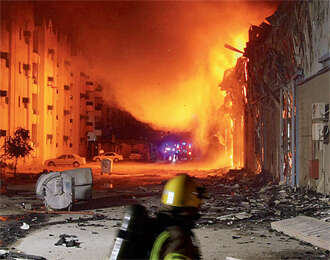 Charred body found in gutted warehouse