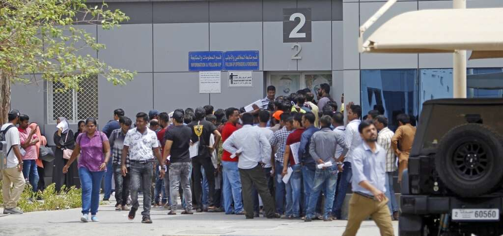 Amnesty seekers line up to get their out pass at the General Directorate Of Residency And Foreigners Affairs in Sharjah.- Photo by M. Sajjad