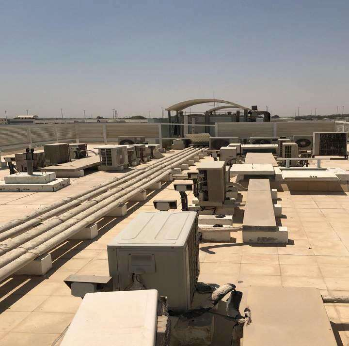 Abu Dhabi, building owners, booked, warned, untidy rooftops,