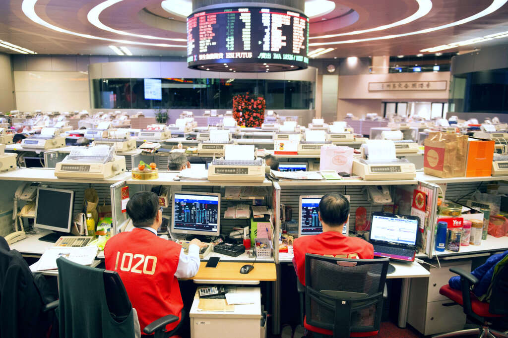 Traders work on the trading floor of the Hong Kong Stock Exchange during the first day of trading after lunar new year in Hong Kong, China, on Thursday.