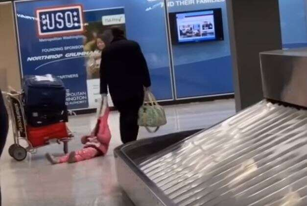 Man drags daughter through airport by her hood
