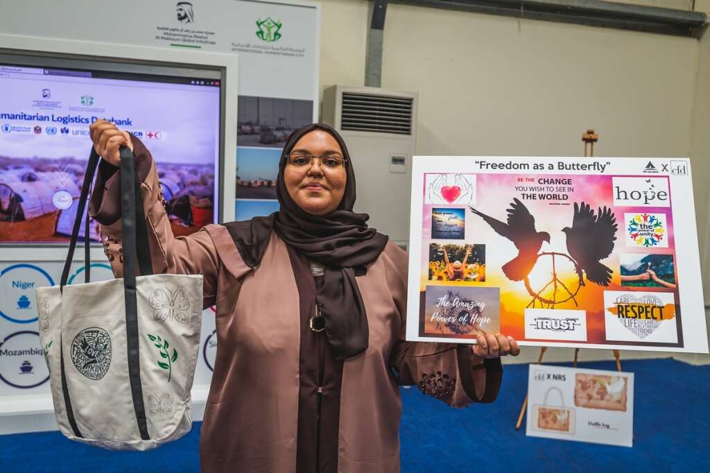 Amira Saif from Yemen presenting the Freedom as a butterfly bag that she designed during the Bag of Hope program in Dubai.-Photo by Neeraj Murali.