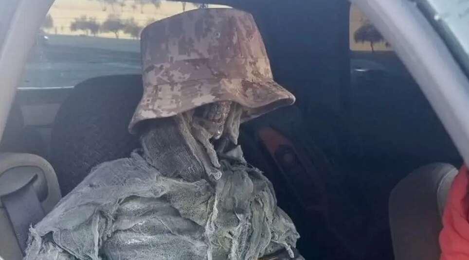 skeleton in car, driving rules, arizona police