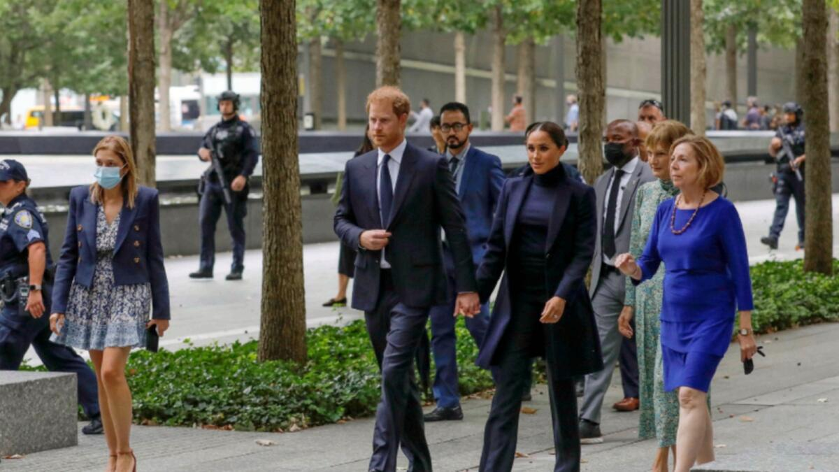 Britain's Prince Harry and Meghan walk while visiting the 9/11 Memorial in Manhattan, New York City. — Reuters