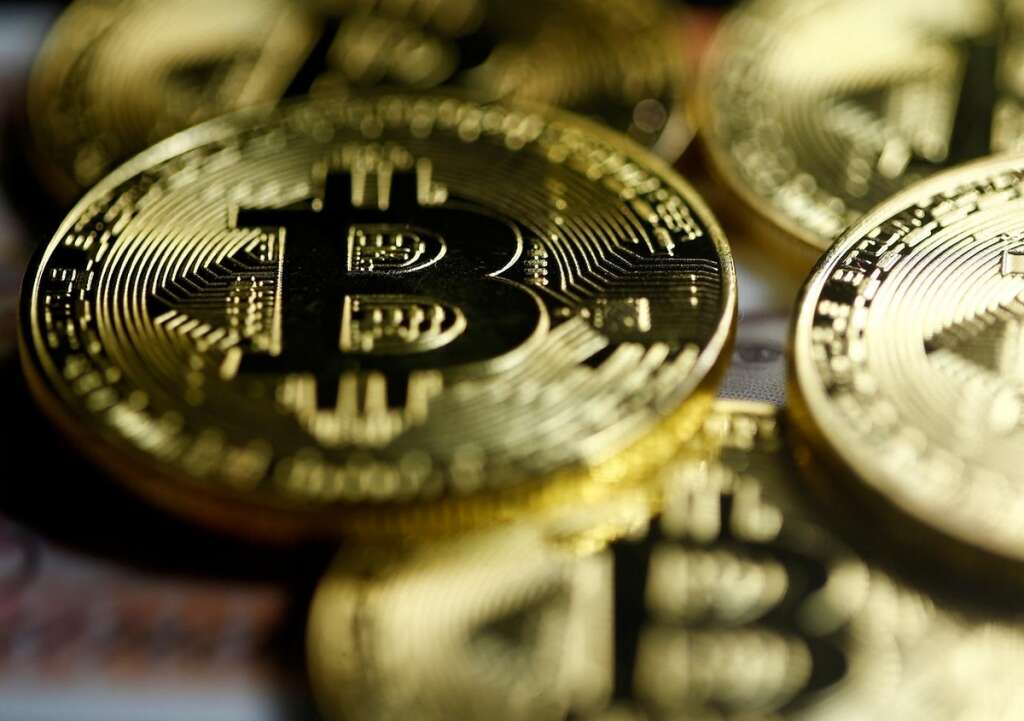 Bitcoin slides to 6-month low on China crackdown