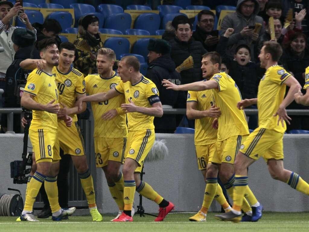 4ee159da04f Kazakhstan's players celebrate after Kazakhstan's Yuriy Pertsukh (left)  scored a goal against Scotland during the Euro 2020 group I qualifier