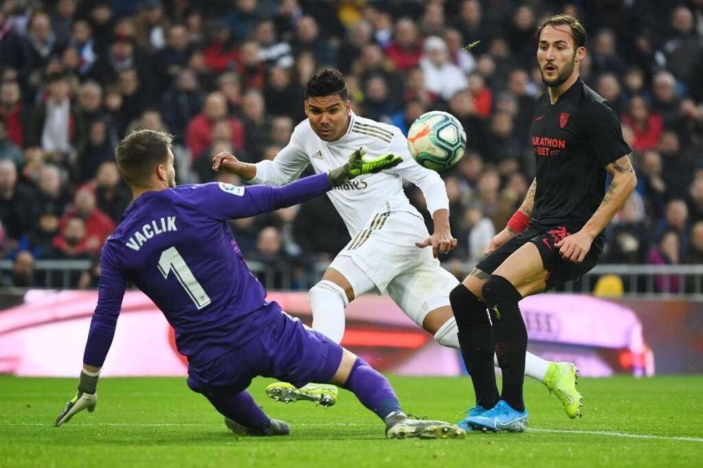 Madrid go top after scrappy win over Sevilla