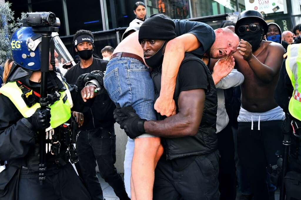 Patrick Hutchinson, black, protester, carrying, white man, anti-racism, protest, far-right, opponents, Reuters, photo, viral, London, Britain