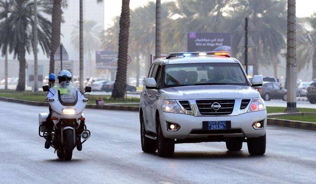 Police patrol car and bike in action on the Sharjah roads