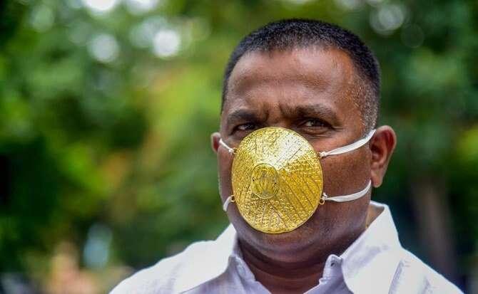 Coronavirus, Man, wears, gold mask, ward off, Covid-19