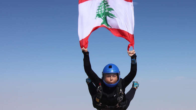 lebanon, daredevil, expat, skydive, uae, nada abou mattar, lebanon protests, flag