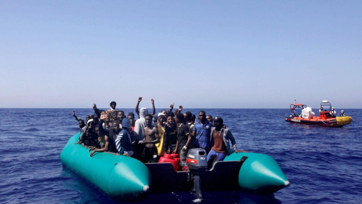 African migrants on a rubber boat in the Mediterranean Sea, off Libya are being rescued by the MV Geo Barents vessel of MSF (Doctors Without Borders) NGO, in the central mediterranean route. — AP