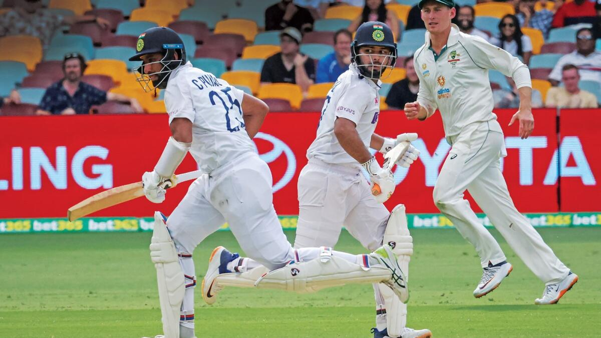 India's batsmen Cheteshwar Pujara (left) and Rishabh Pant during the final day of the  the fourth Test against Australia. (AFP)