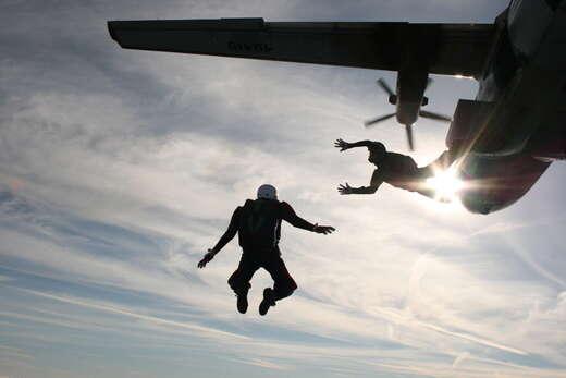 Woman survives skydive after parachute fails to open