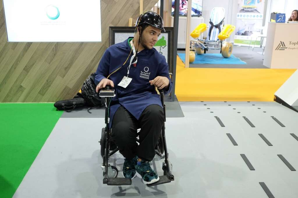 Emirati, students, develop, wheelchair, moves, swaying, head, AccessAbilities Expo