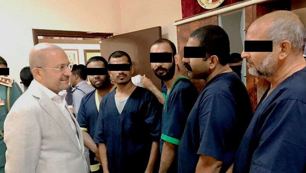Merchant with some of the inmates who received help from him to clear their debts and got released.