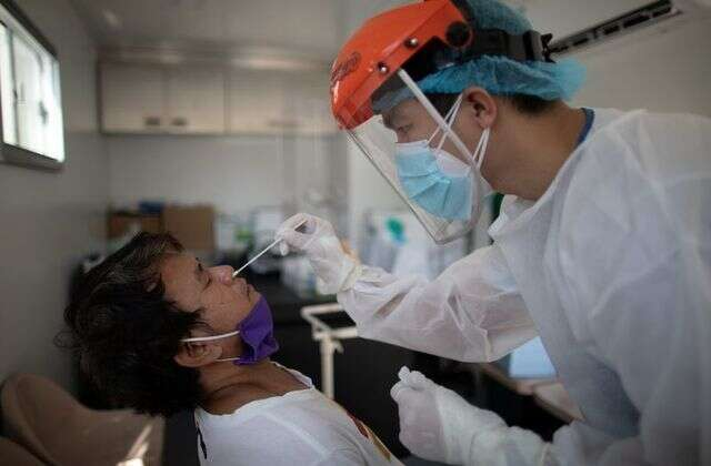 Covid-19 tests, OFWs, Filipino expats , debt, Red Cross, Manila