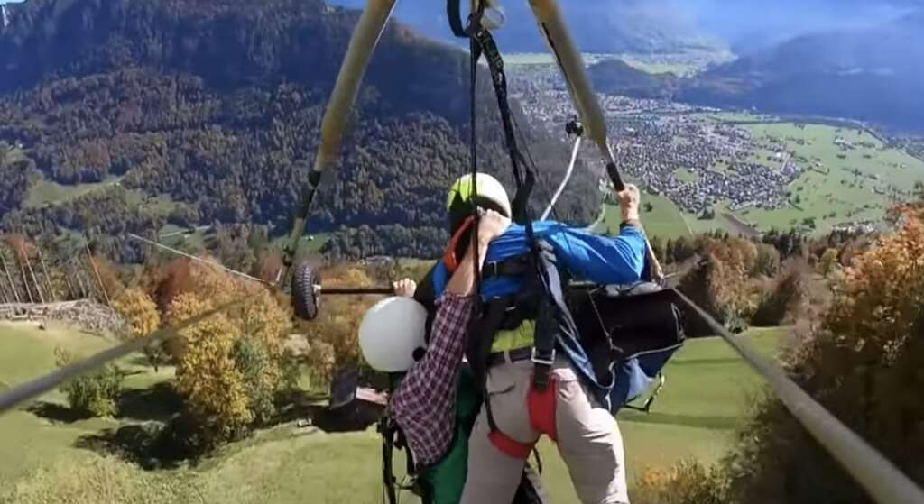 Video: Man on glider hangs on for life after pilot forgets harness
