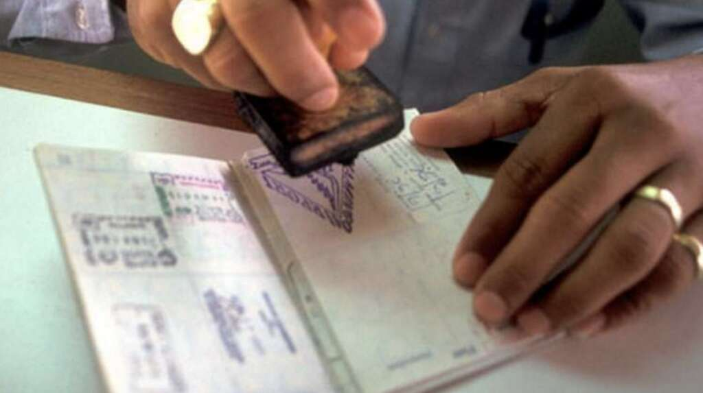 Is it illegal to work in UAE during visa transition period?