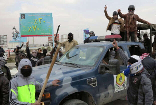 Al Qaeda-linked fighters control parts of two Iraq cities