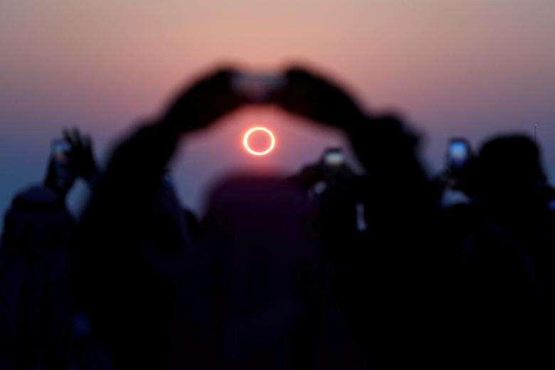 UAE, witness, partial solar eclipse, June 21