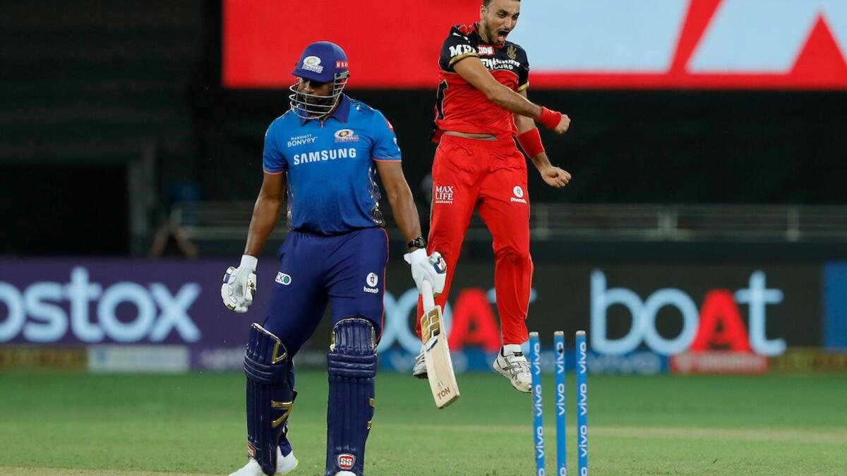 Royal Challengers Bangalore's Harshal Patel celebrates after dismissing Kieron Pollard of the Mumbai Indians in Dubai on Sunday night. — BCCI
