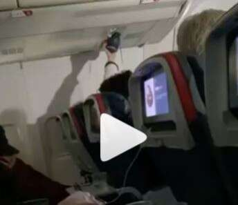Video, Airline, passenger, uses, air conditioning, vent, as, personal, shoe dryer,