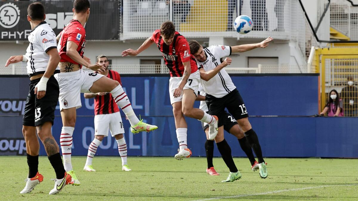 AC Milan's Daniel Maldini (second from right) heads home against Spezia in the Serie A on Saturday. — Reuters