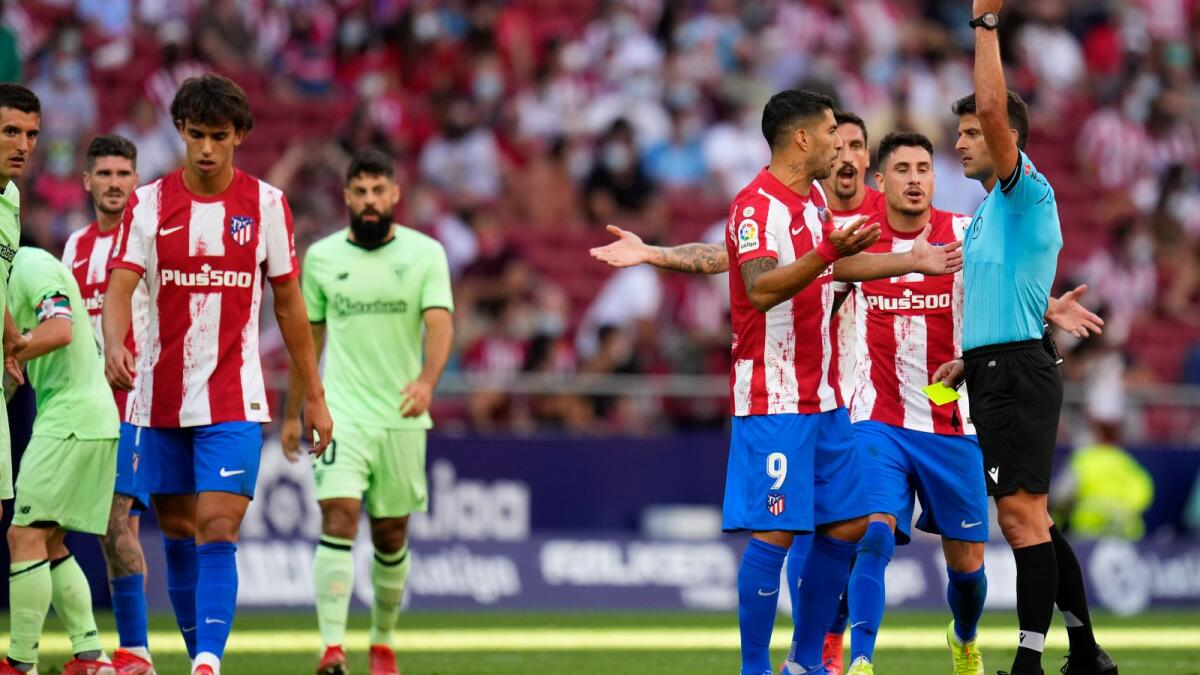 Atletico Madrid's Joao Felix (left) is shown the red card during a Spanish La Liga match against Athletic Bilbao at Wanda Metropolitano stadium. — AP