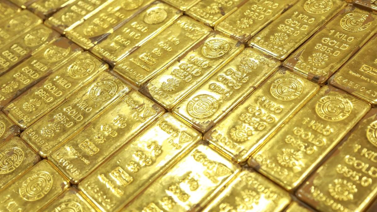 Gold price drops after hitting nearly 2-week high