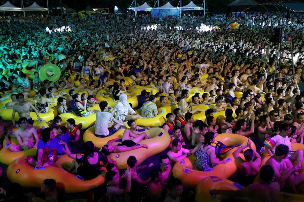 china, Chinese, state, newspapers, support, Wuhan maya beach water park, pool, party, coronavirus, Covid-19, fears