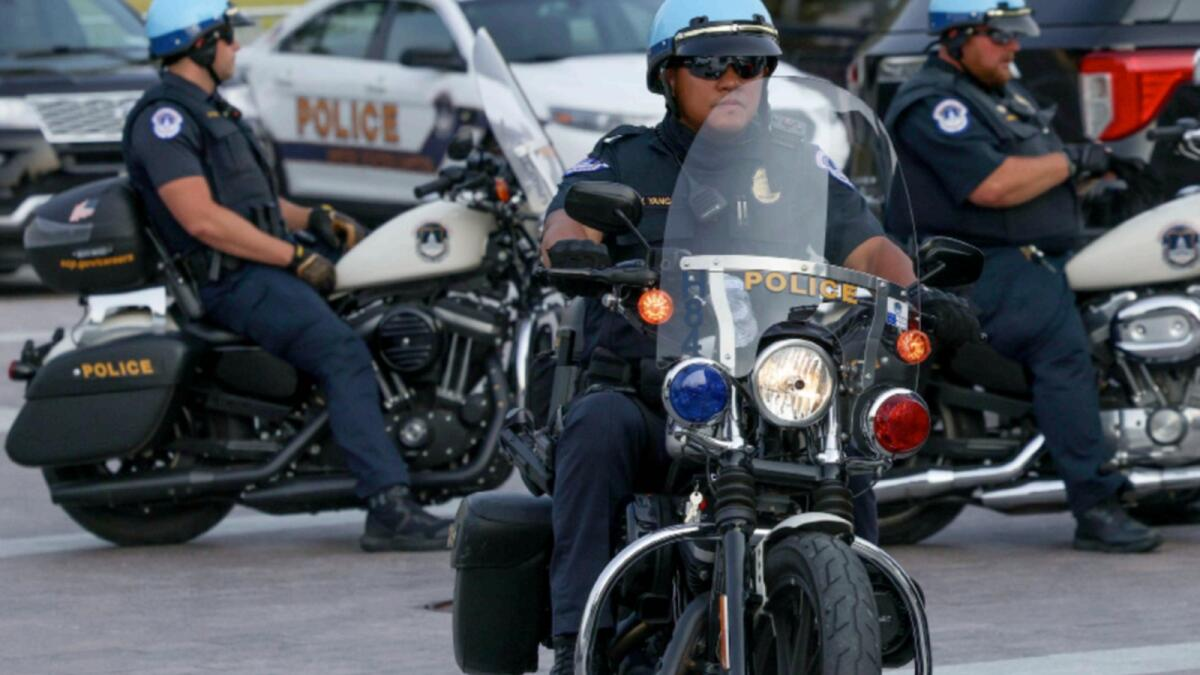 Capitol police on motorcycles sit outside the United States Capitol building in Washington. — Reuters