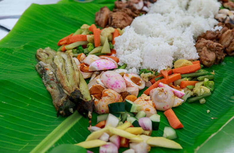 A Boodle Fight Meal Served On Banana Leaves Alamy