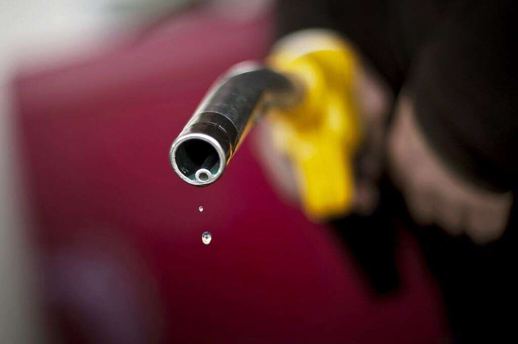 This file picture shows a driver after refueling at a Dijons gas station.