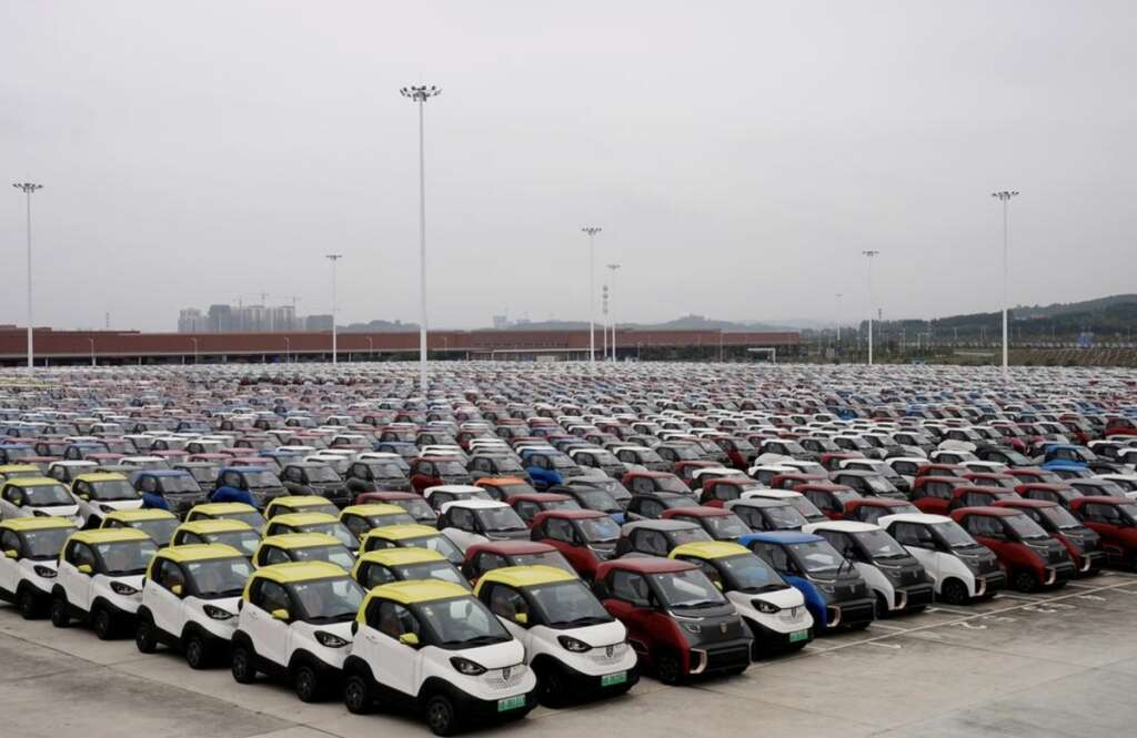 China, electric car quotas, delay emission rules