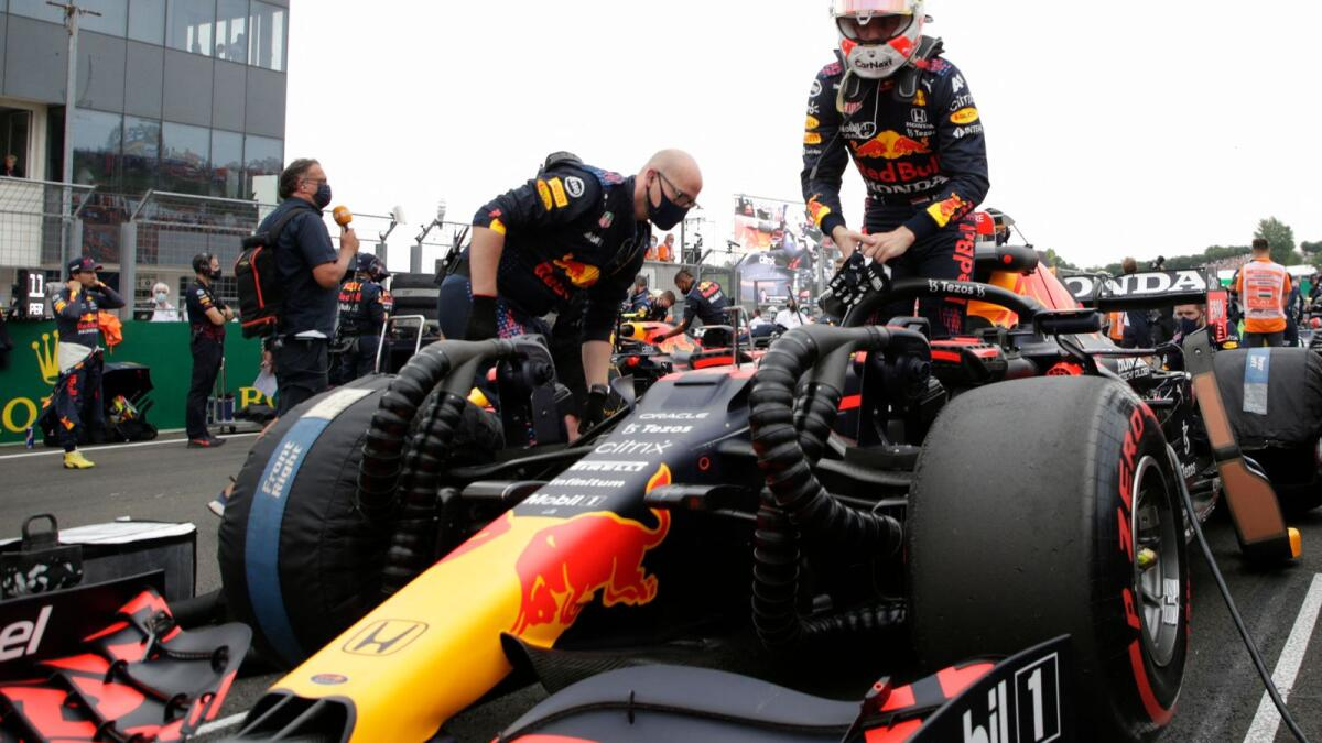 Red Bull's Dutch driver Max Verstappen gets into his car ahead of the Formula One Hungarian Grand Prix at the Hungaroring race track in Mogyorod near Budapest. — AFP
