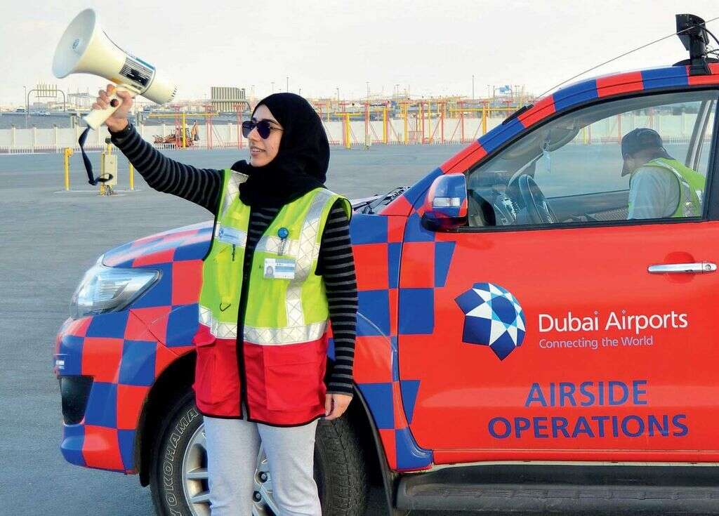 Emirati compliance and safeguarding officer Reem Al Saffar implements bird dispersal methods at the airport.