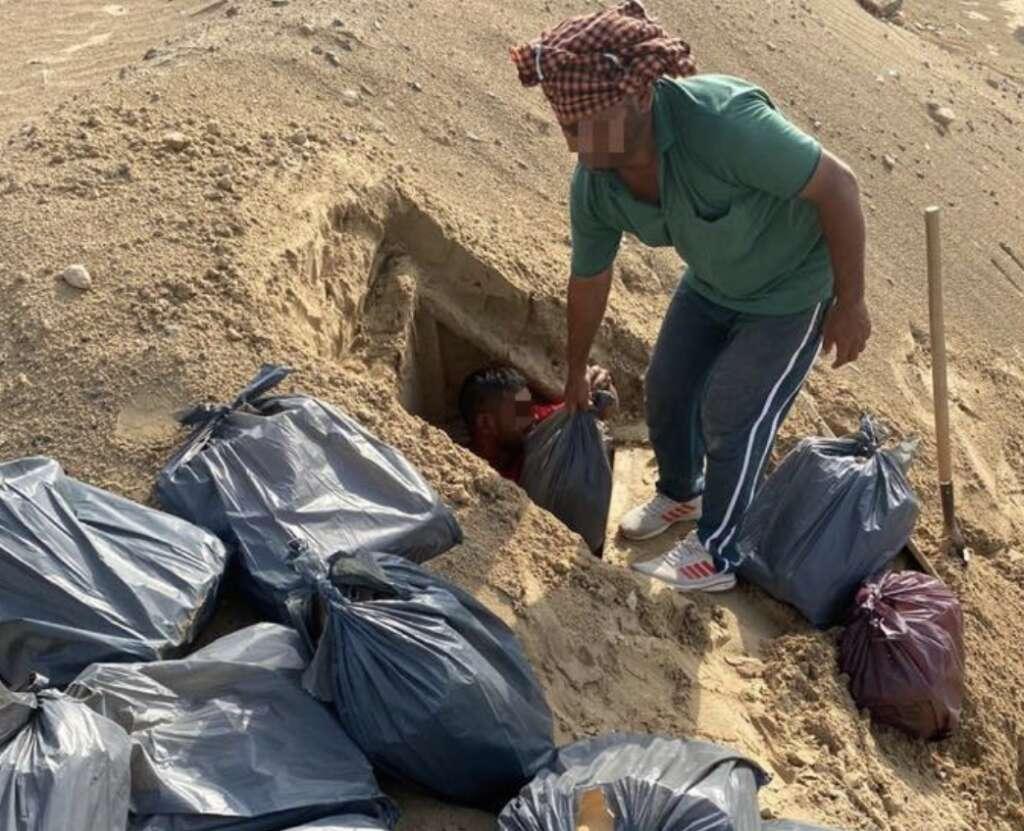 1,100 alcohol bottles, seized, pit, middle of Dubai desert