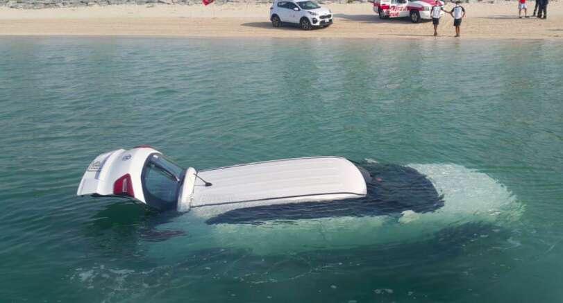 Woman, Dubai, drives car, sea, receiving, bad news, phone