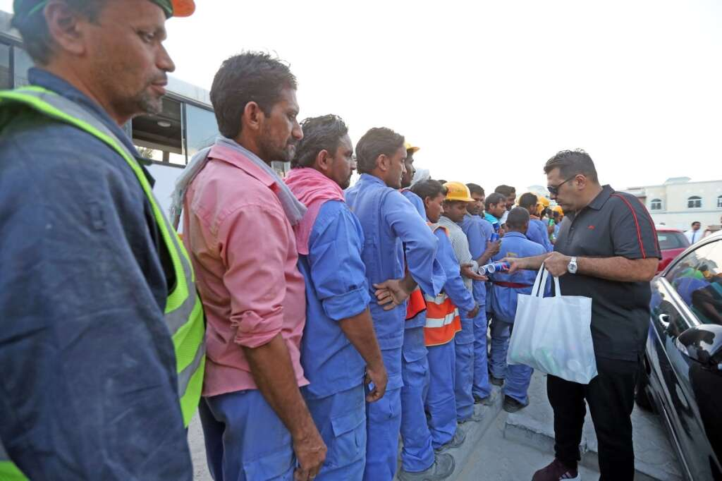 Imran Karim distributes food and drinks to workers along the Jumeirah Road in Dubai.— Photo by Dhes Handumon/ Khaleej Times