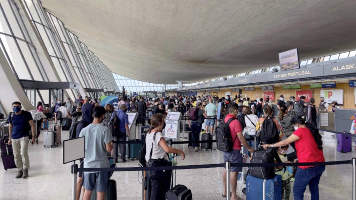 Passengers at Dulles Washington International Airport (IAD) in Dulles, Virginia. — AFP file